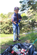 Cub scout picking up trash at Earth Day 2018