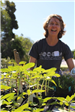 Woman planting greens at Earth Day 2018