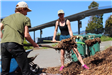 Volunteers shoveling woodchips at Earth Day 2018